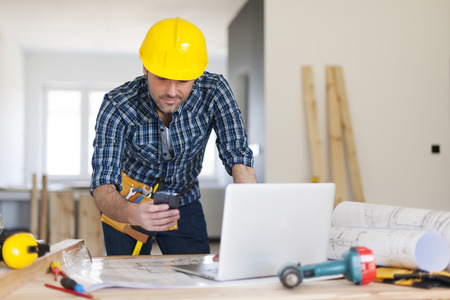 Photo pour Busy building contractor at work  - image libre de droit