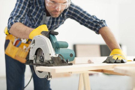 Photo for Carpenter working with circular saw - Royalty Free Image