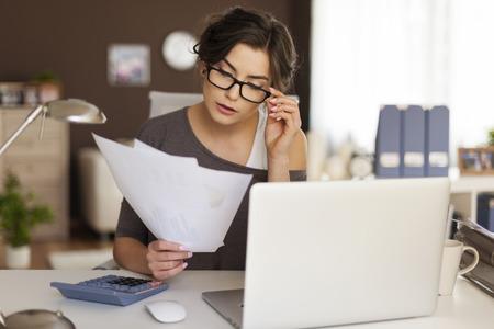 Foto de Young woman hard working at home  - Imagen libre de derechos