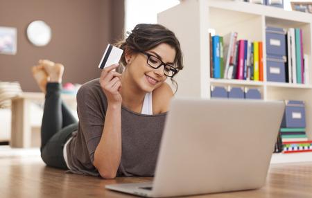 Foto de Happy woman doing online shopping at home  - Imagen libre de derechos