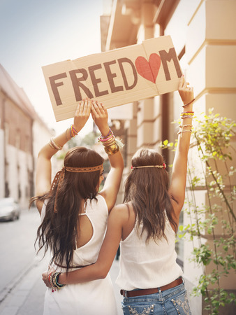 Photo pour Boho girls with label with text Freedom - image libre de droit