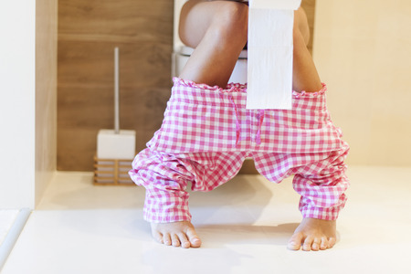 Foto de Close up of woman on toilet in morning  - Imagen libre de derechos