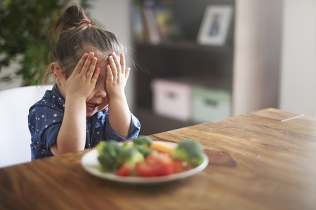 Photo pour I hate a vegetables! I'm not eating this! - image libre de droit