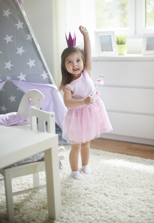Photo pour Little cute fairy with magic wand - image libre de droit