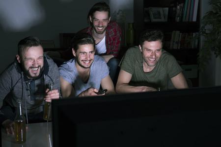 Foto de Funny movie at manly evening - Imagen libre de derechos