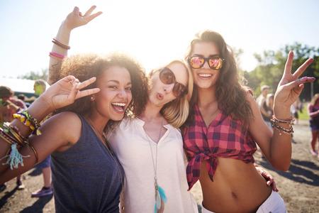 Photo pour Three best friends at the festival - image libre de droit