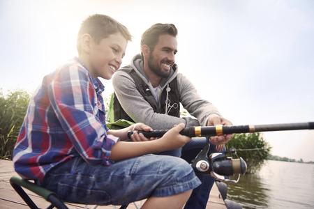 Foto de Fishing by the lake is our common passion - Imagen libre de derechos