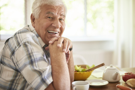 Photo for Senior man relaxing after breakfast - Royalty Free Image