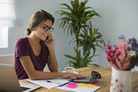 Photo pour Busy accountant working at home - image libre de droit