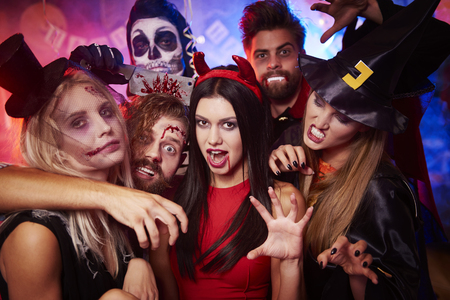 Photo for Group of creepy friends at the party - Royalty Free Image