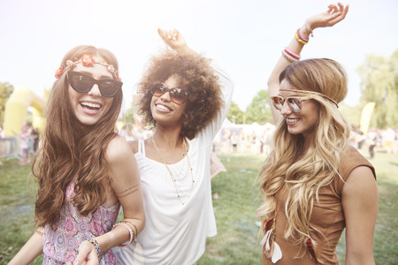 Photo for Playful young girls at summer festival - Royalty Free Image