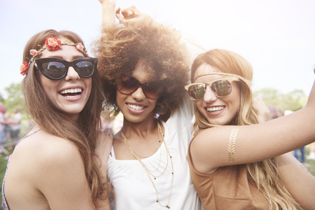Photo for Three of girls spending time togheter in festival - Royalty Free Image