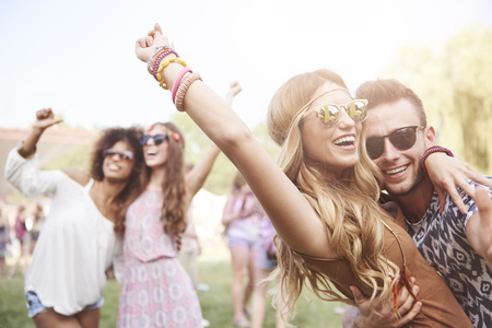 Photo for Young and cheerful couple in music festival - Royalty Free Image