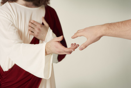 Photo for Jesus saving hand reaching for the faithful - Royalty Free Image