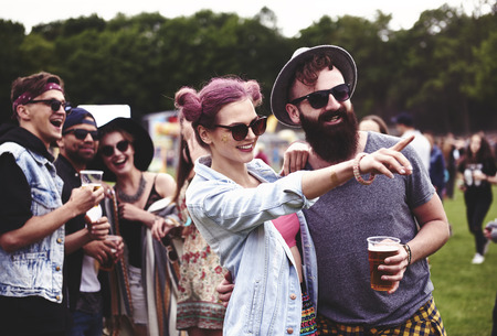 Photo for Couple standing in crowd at music festival - Royalty Free Image