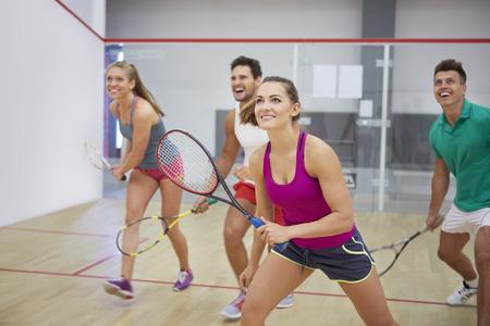 Photo pour Affectionate friends during the squash game - image libre de droit