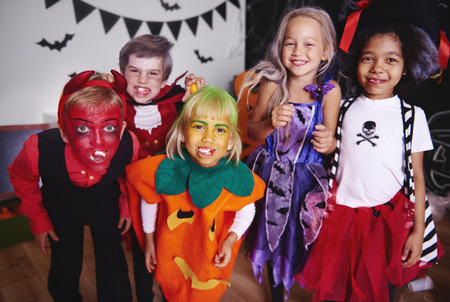 Photo pour Kids posing  in halloween costume - image libre de droit