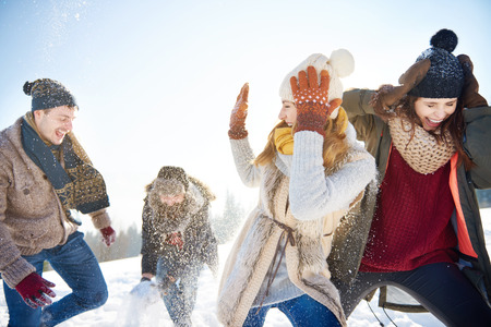 Photo for Snow fight between two couples - Royalty Free Image