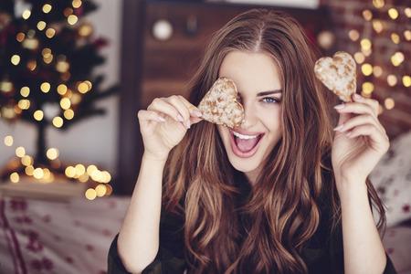 Foto de Crazy woman holding cookies in hand - Imagen libre de derechos