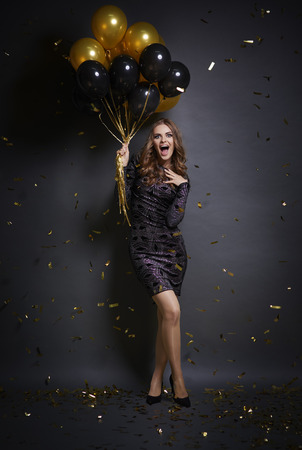 Foto de Ecstatic woman  with ballons at studio shot  - Imagen libre de derechos