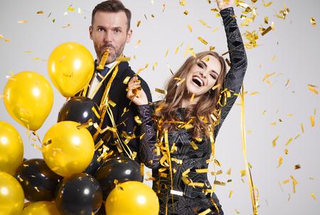 Foto de Couple dancing among falling confetti and streamer at party - Imagen libre de derechos