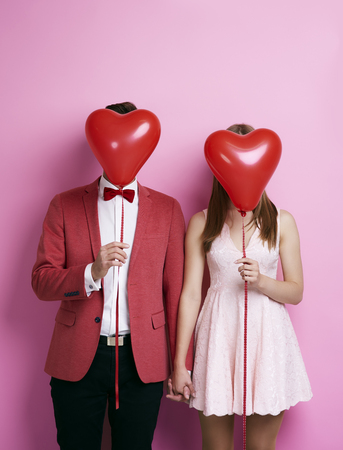 Photo for Unrecognizable couple with balloon holding hands  - Royalty Free Image