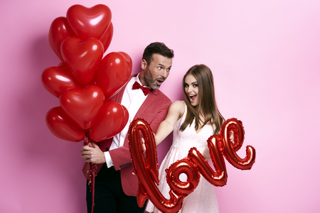 Foto de Couple make preparations for Valentine's party  - Imagen libre de derechos