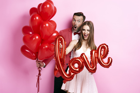 Photo for Man with balloon embracing his girlfriend - Royalty Free Image