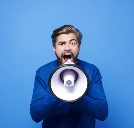 Photo for Screaming man with megaphone shouting  - Royalty Free Image