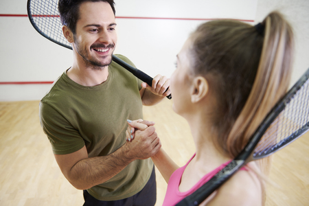 Photo for Man and woman shaking hands before squash game  - Royalty Free Image