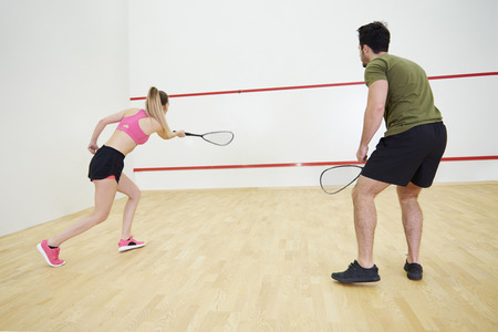 Photo for Man and woman playing squash   - Royalty Free Image