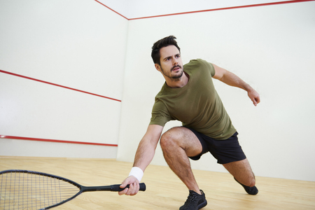 Photo pour Man during squash match on court  - image libre de droit
