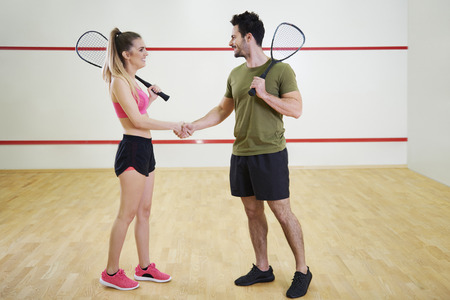 Photo for Cheerful squash players shaking hands  - Royalty Free Image