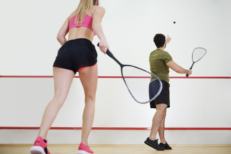 Photo for Rear view of man and woman playing squash together  - Royalty Free Image