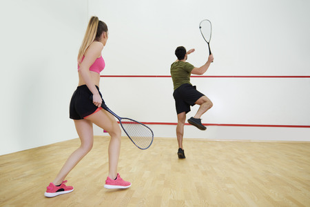 Photo for Rear view of couple during the squash game  - Royalty Free Image