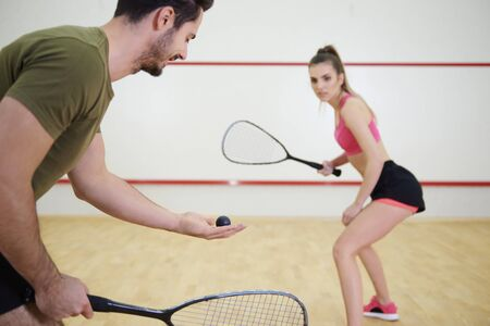 Photo for Athletic couple playing squash together   - Royalty Free Image