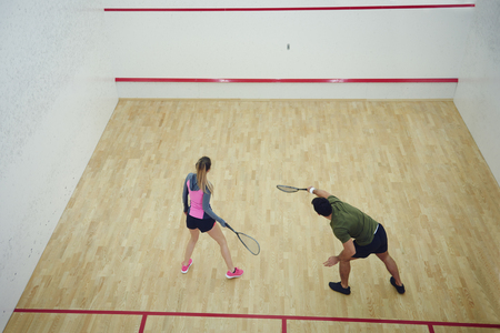 Photo for Two friends playing squash together   - Royalty Free Image