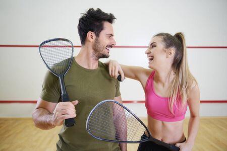 Photo pour Squash couple flirting on court  - image libre de droit