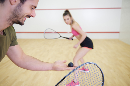 Photo for Couple playing squash at court  - Royalty Free Image