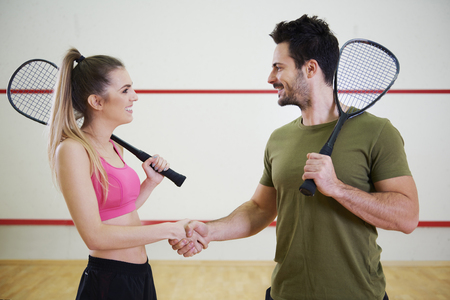 Photo for Squash player or tennis player congratulating each other - Royalty Free Image