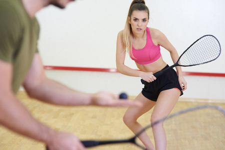 Photo for Friends playing squash at court  - Royalty Free Image