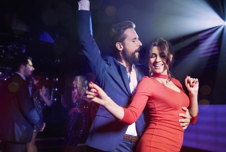 Photo pour Couple flirting at night club   - image libre de droit