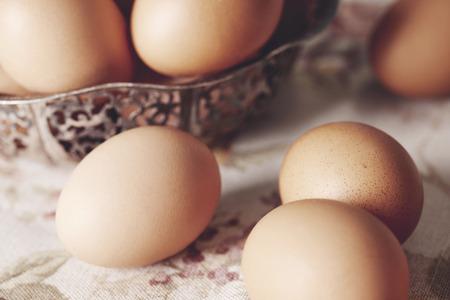 Foto de Close up of brown eggs on table  - Imagen libre de derechos