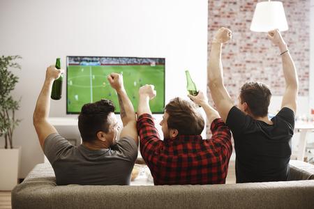 Foto de Rear view of men watching match and cheering  - Imagen libre de derechos