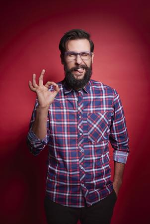 Photo for Man showing ok sign at studio shot  - Royalty Free Image