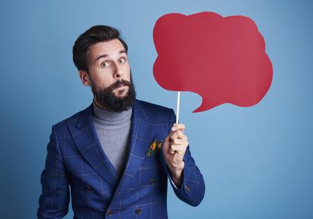 Photo pour Man holding a speech bubble  - image libre de droit