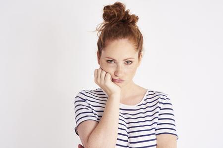 Photo pour Portrait of bored and resentful woman at studio shot - image libre de droit