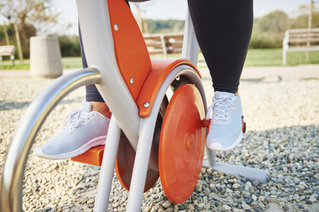 Photo for Part of woman using exercise bike - Royalty Free Image