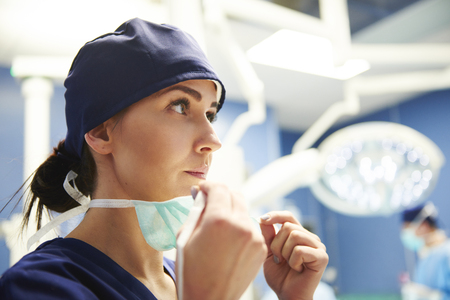 Photo for Female surgeon preparing for the operation  - Royalty Free Image