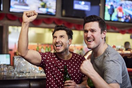 Foto de Grateful sports fans watching sports game - Imagen libre de derechos